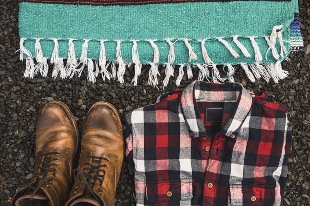 Boots, shirt, and blanket to bring during camping