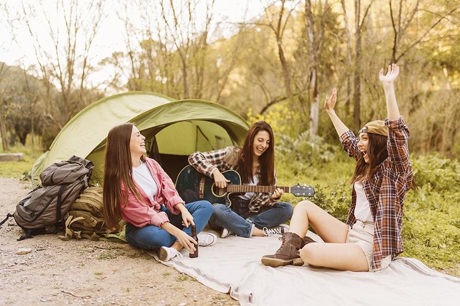 women camping outdoors