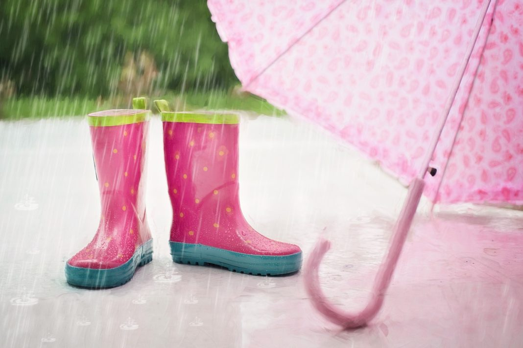 Pink boots and umbrella on the floor