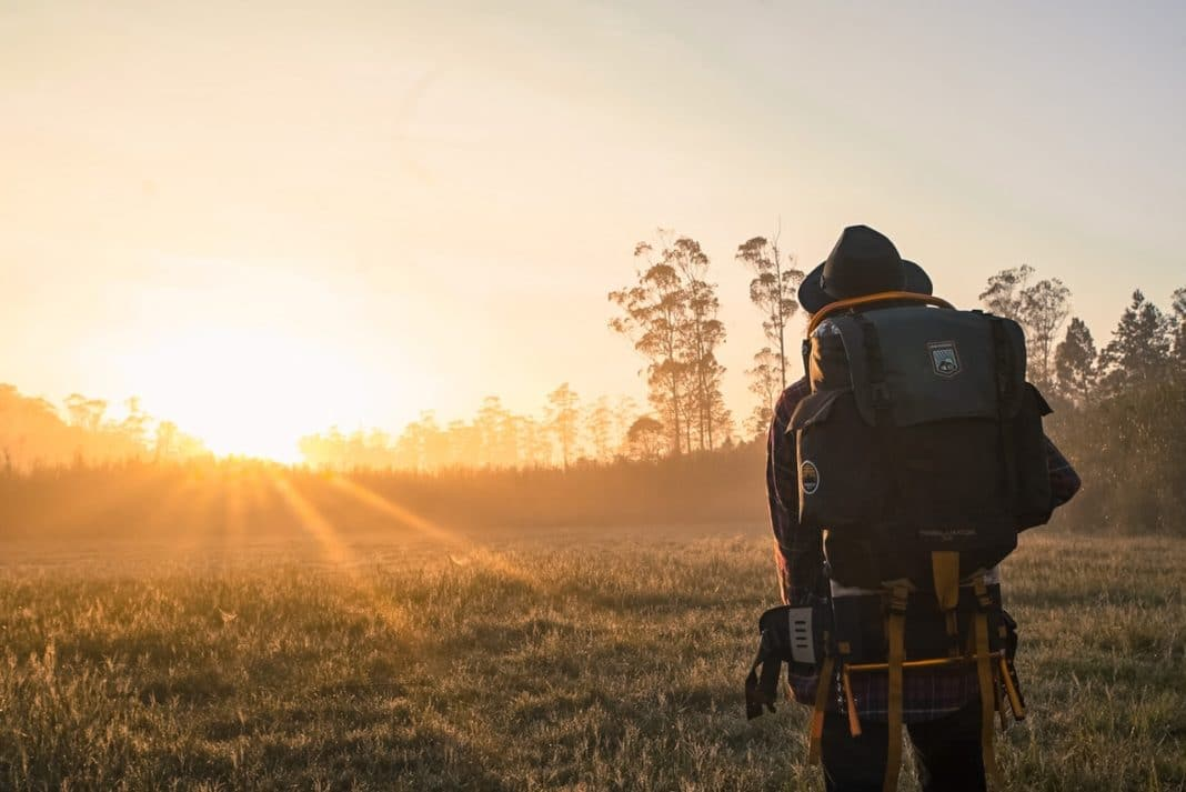best first aid kit for backpacking man-in-black-backpack-during-golden-hour